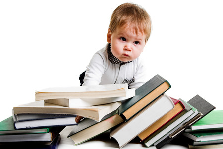little boy with lots of books photo