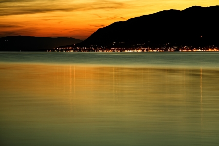 Night beach in Montenegro with beautiful light reflections over water photo