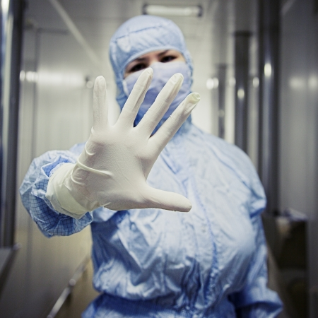 biotechnology researcher in protect wear Stock Photo
