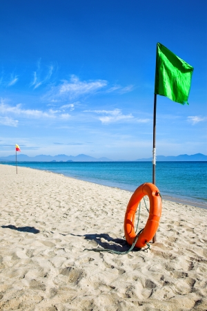 Beach green flag good weather wind Stock Photo - 24435544