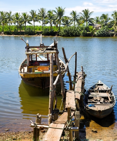 fishers: two fishers boats on the tropical river  Stock Photo