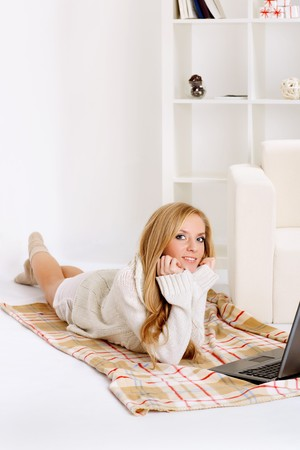 beauty girl with laptop in the room photo