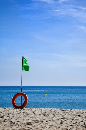 Beach green flag good weather wind Stock Photo - 25465331