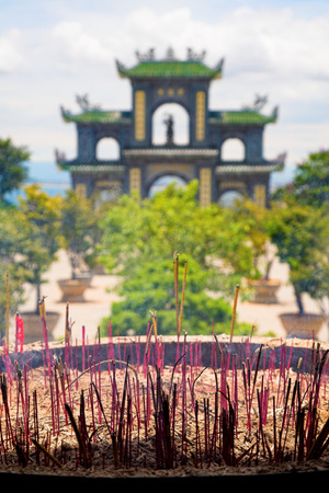 Incense Sticks Burning Outside of Temple photo