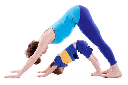 mother and son doing yoga. isolated on white