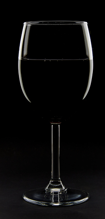 Red wine glass isolated on black
