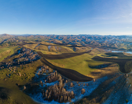 Drone view of autumn meadow hiils and forest. Aerial nature shot. Altai regoin, Russia Stok Fotoğraf