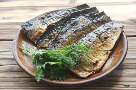 Fried mackerel with dill and parsley