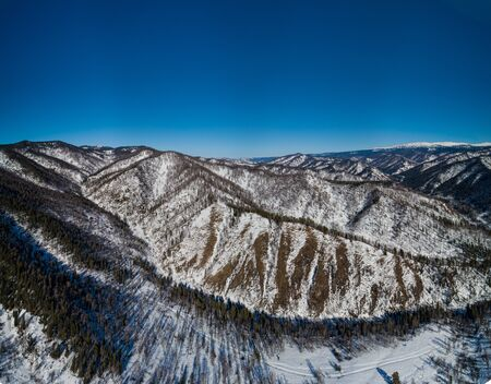 Aerial pano of winter mountain, Altay region. Landscape photo captured with drone.