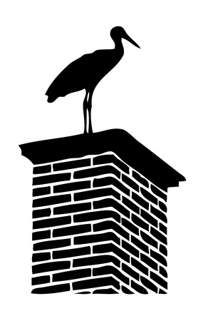 silhouette of stork on chimney