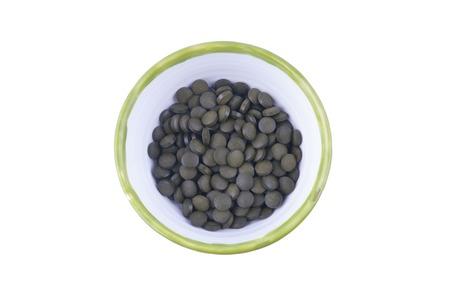 chlorella tablets on white background