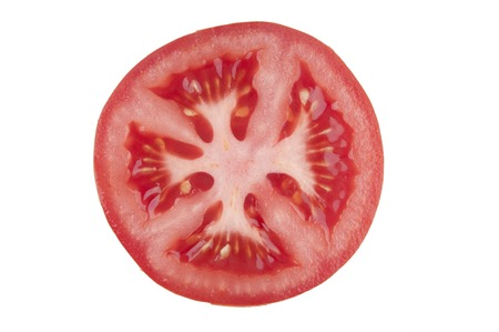 Slice tomato on white background