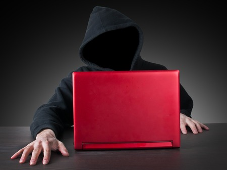 anonym: anonym hacker with hood and red laptop