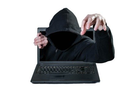 affluence: Scary man without face reaching out from the computer, danger from network Stock Photo