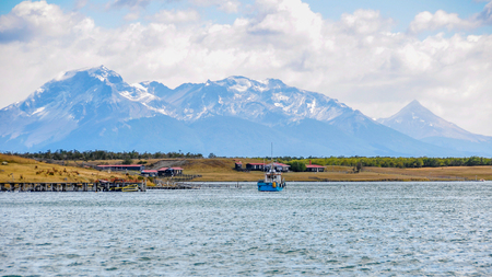 puerto natales: A lonely boat crossing the strait in Puerto Natales, Patagonia, Chile