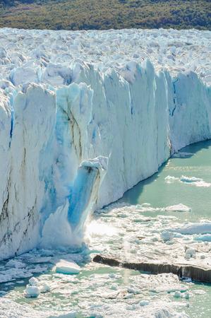 calving: Ice falling at the Perito Moreno Glacier, Patagonia, Argentina Stock Photo