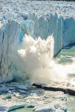 calving: Ice falling at the Perito Moreno Glacier, Patagonia, Argentina Stock Photo
