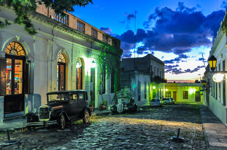 Evening lights on a Cobblestone street in Colonia del Sacramento, Uruguay. Banco de Imagens