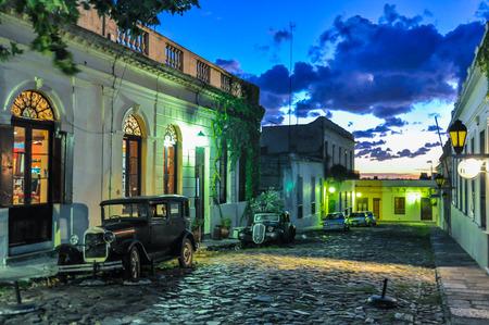 colonia del sacramento: Evening lights on a Cobblestone street in Colonia del Sacramento, Uruguay. Stock Photo