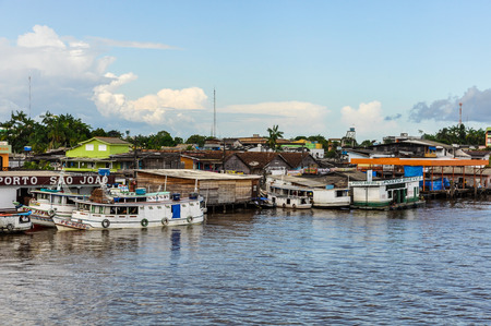amazon river: Riverside village as seen from the boat on the Amazon River in Brazil. Stock Photo