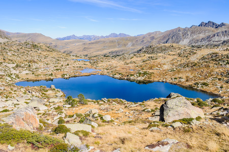 tourism in andorra: Panoramic view of the lakes in the circuit of Lake Pessons, Andorra Stock Photo