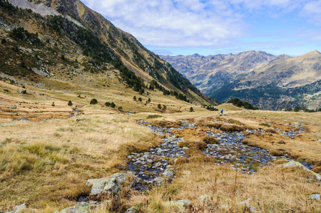 tourism in andorra: Calm stream in Fall, in the Valley of Estanyo River, Andorra