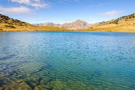 tourism in andorra: The Estanyo Lake in Fall, in the Valley of Estanyo River, Andorra Stock Photo