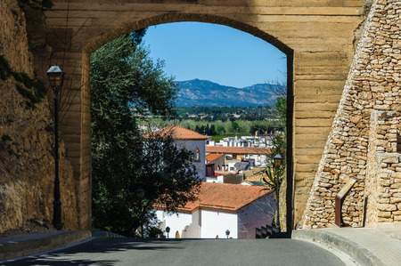 ebre: The town and the mountains through a gate in Tortosa, Catalonia, Spain Stock Photo