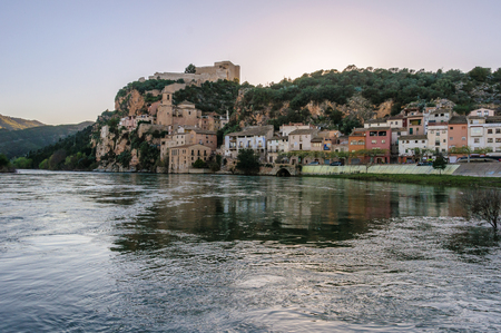 ebre: View of Miravet Castle from the riverside of Ebro at sunset in Catalonia, Spain Stock Photo