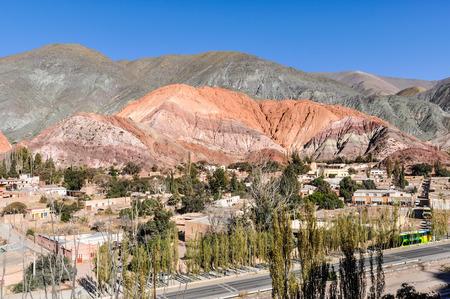 colores: Distant view of Cerro de los Siete Colores in the Quebrada de la Humahuaca, Purnamarca, Argentina
