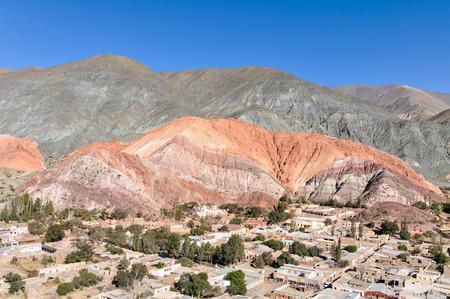 siete: Distant view of Cerro de los Siete Colores in the Quebrada de la Humahuaca, Purnamarca, Argentina