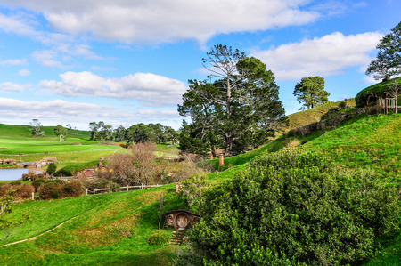 cottage fence: View of the village in Lord of the Rings location Hobbiton, Matamata, New Zealand