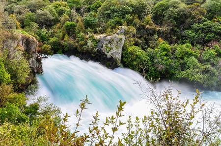 Side view of the rushing wild stream of Huka Falls near Lake Taupo, New Zealand