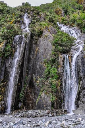 josef: Waterfalls in the valley of Franz Josef Glacier in New Zealand