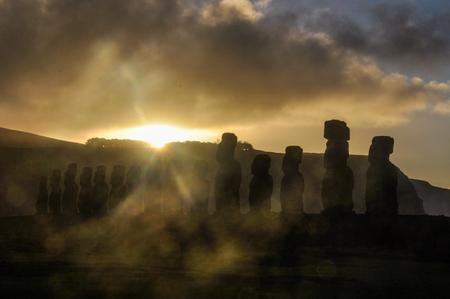 moai: Sunsrise at the Ahu Tongariki moai site on the coast of Easter Island, Chile