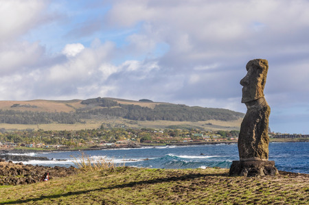 moai: Lonely moai statue in the Ahu Tahai site on Easter Island, Chile
