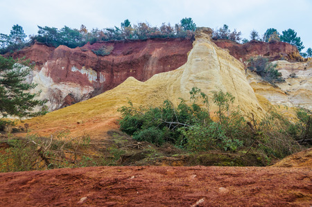 ochre: Colorful rock formations, results of ochre mining in the Colorado Provenzal, Provence, France Stock Photo