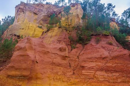 ochre: Colorful rocks made of ochre near the hilltop village of Rousillon, Provence, France