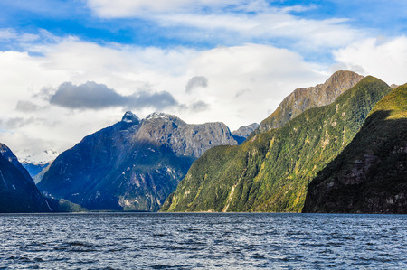 navigating: Navigating in the Milford Sound, one of the most beautiful fiords in New Zealand Stock Photo
