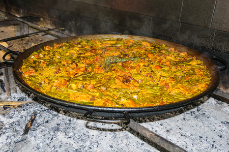 kitchen spanish: Traditional Valencian Paella with meat and chicken In Valencia, Spain Stock Photo