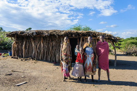 A Datoga family in front of their home at Lake Eyasi, Tanzania Editorial