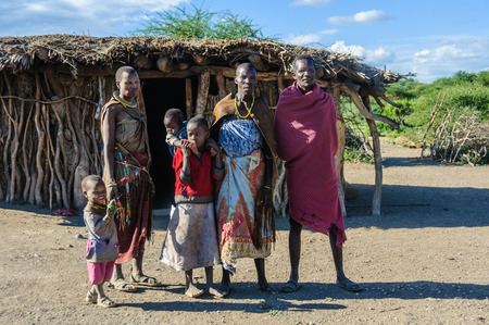 hunter gatherer: A Datoga family in front of their home at Lake Eyasi, Tanzania Editorial