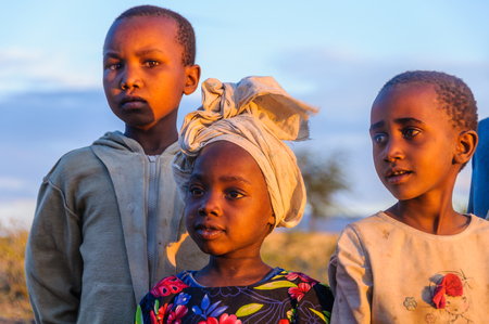 hunter gatherer: Kids from a Datoga tribe playing at sunset at Lake Eyasi, Tanzania