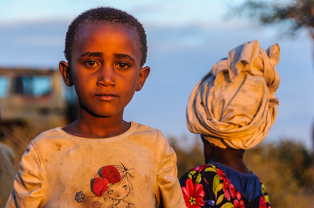 gatherer: Kids from a Datoga tribe playing at sunset at Lake Eyasi, Tanzania