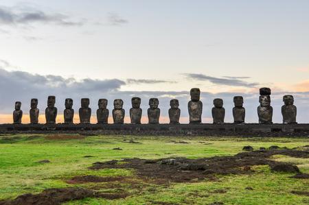 Sunrise at the Ahu Tongariki moai site on the coast of Easter Island, Chile