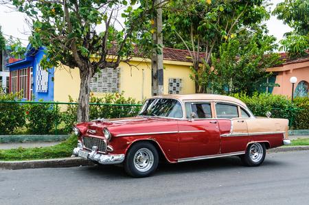 oldschool: Oldschool, vintage automobile parked in Cienfuegos, Cuba