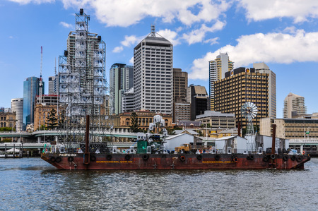 qld: Boat passing in front of the Central Business District in Brisbane, Australia Editorial