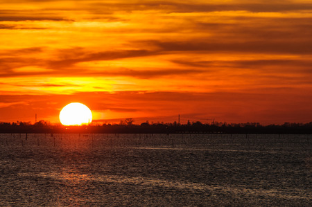 Colorful sunset at the lagoon near Chioggia, Italy