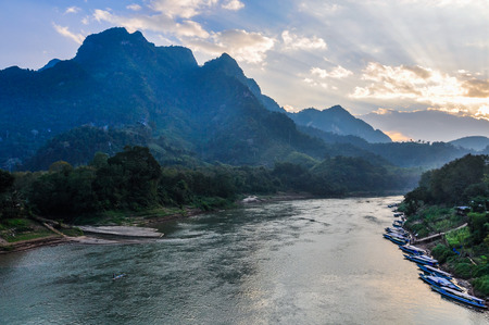 Colorful sunset on the Nam Ou River in Nong Khiaw, Laos Stock Photo