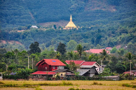 Village and golden stupa in the village Luang Nam Tha, Northern Laos